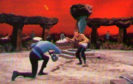 Kirk and Spock surround each othr with lirpas